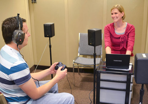 Student researcher, Karen Storey, and research participant conducting research with the KUDUwave Audiometer