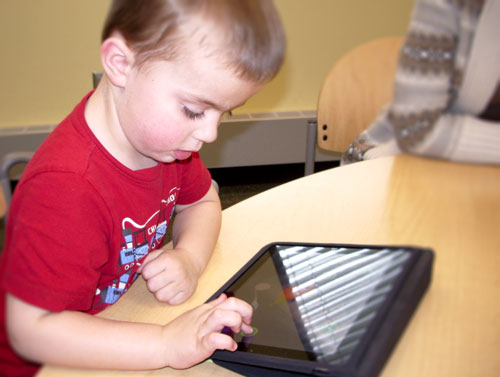 A Child Learning With an iPad