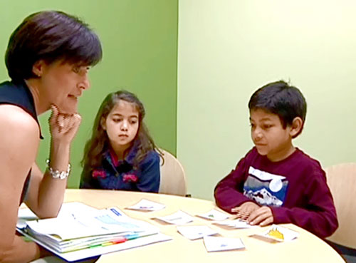 Dr. Sandy Gillam working with three children