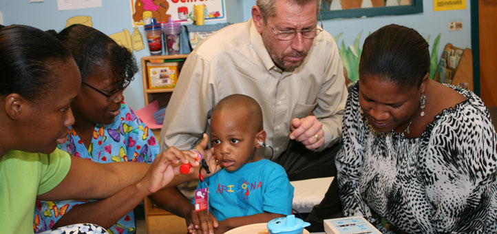 An early childhood hearing screening testing session in progress